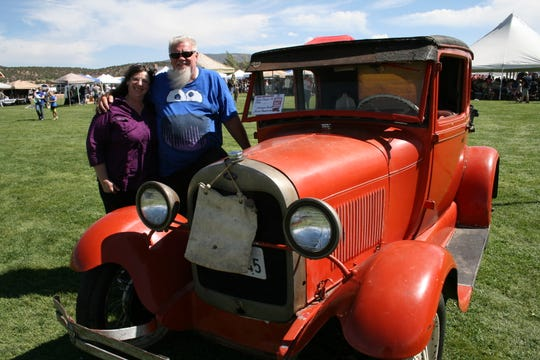 Jim and LaCynda Carter of Enterprise stand next to a 1929 Ford Model A. LaCynda's grandfather was the car's original owner.