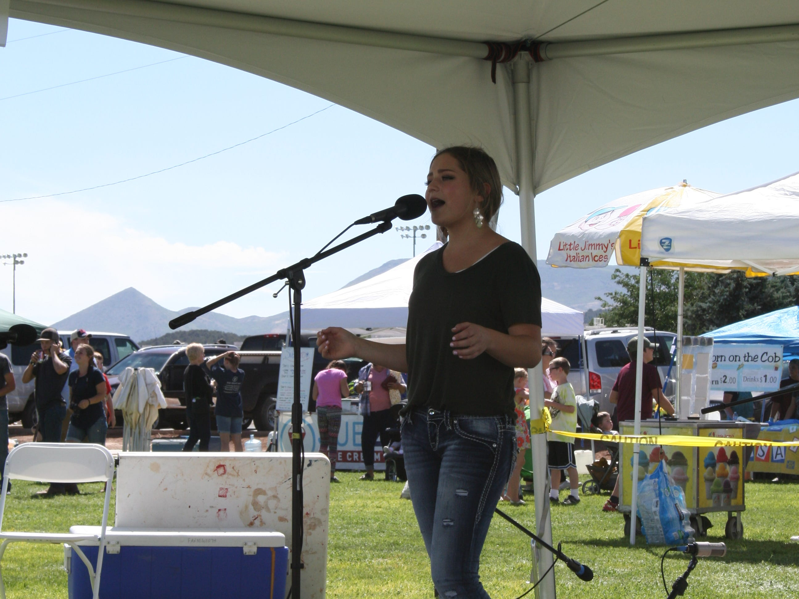 Celeste Carter sings at Cornfest in Enterprise on Aug. 25, 2018.