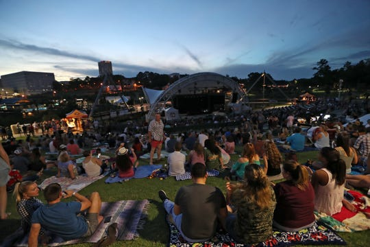 People watch as Train performs with opening act Brightside at the Capital City Amphitheater at Cascades Park on June 21, 2018. The area is set to see big changes with the $158-million mixed-use development on East Gaines Street, north of Cascades Park.