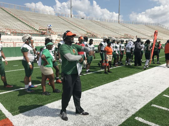 FAMU head coach Willie Simmons calls in the plays from the sideline.