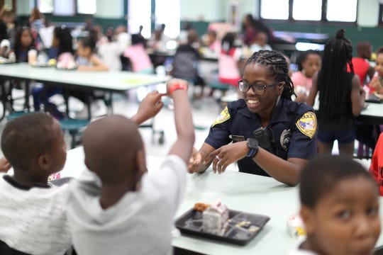 """Tallahassee Police Officer Emily Howell interacts with children in the lunchroom as she works her first day as a school resource officer at Bond Elementary School Thursday, August 16, 2018. """"Parents expect their kids to come every day and I wanted to be the one that helps make that happen,"""" said Howell who volunteered for the extra shifts covering city elementary schools, a new program implemented this school year by the TPD."""