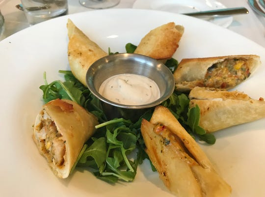 Rooster in the Garden's Southwest spring rolls were fried, crispy, golden tortilla shells filled with grilled chicken, cheese, black beans and corn served with a spicy garlic aioli.