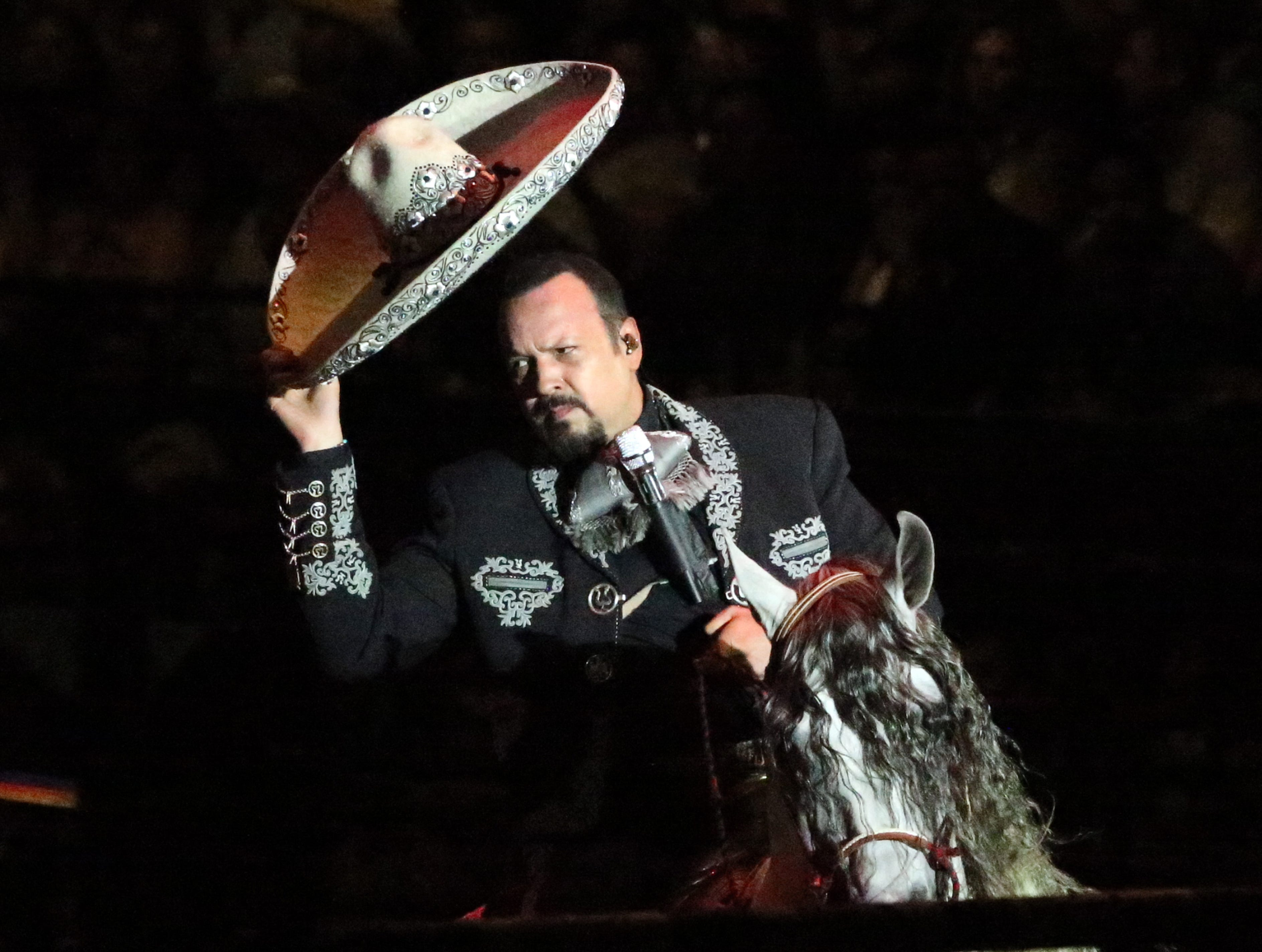 Mexican singer Pepe Aguilar enters the arena to the delight of a sold out crowd during his 'Jaripeo Sin Fronteras' show at El Paso County Coliseum Saturday. Aguilar's family, including son Leonardo Aguilar, 18, daughter Angela Aguilar, 14, and brother Antonio Aguilar performed their own song sets before Pepe rode into a rodeo arena on horseback. The Aguilar family was backed up by a large orchestra and band on a high stage. The show included a set by singer-songwriter Christian Nodal, an all-female horse riding group and bull riding by American and Mexican cowboys all before Pepe Aguilar appeared.