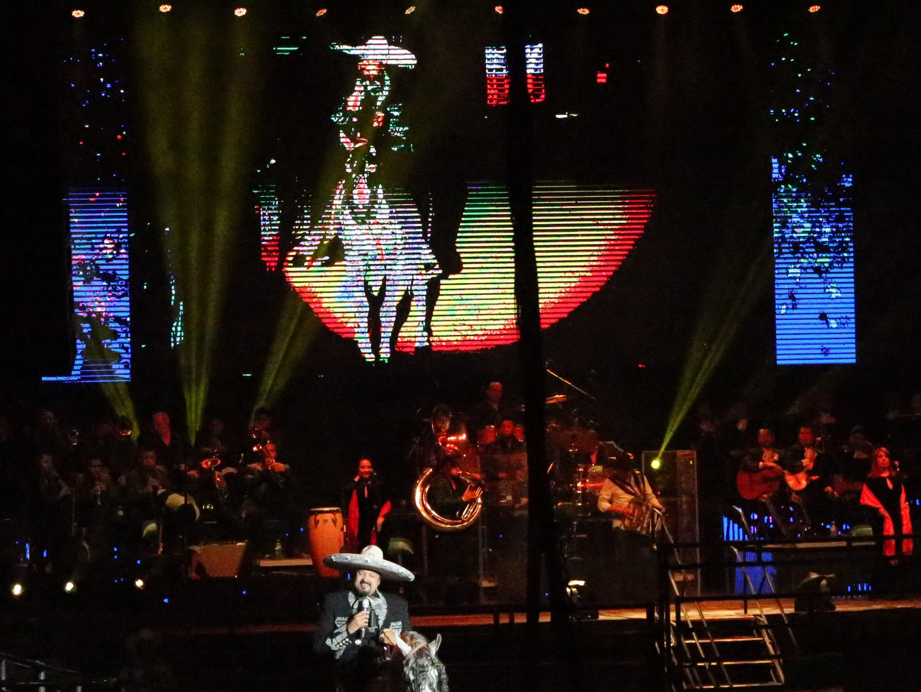 Pepe Aguilar rides into the arena on horseback Saturday night.
