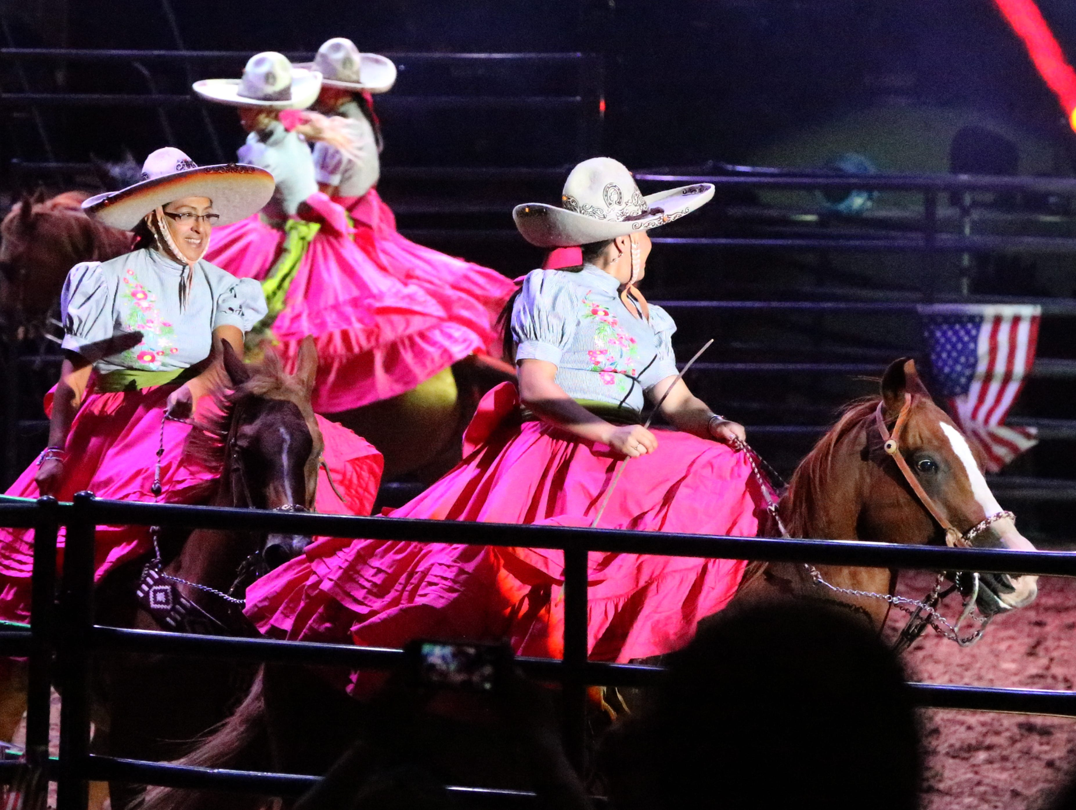An all-female riding group work a series of maneuvers Saturday night.