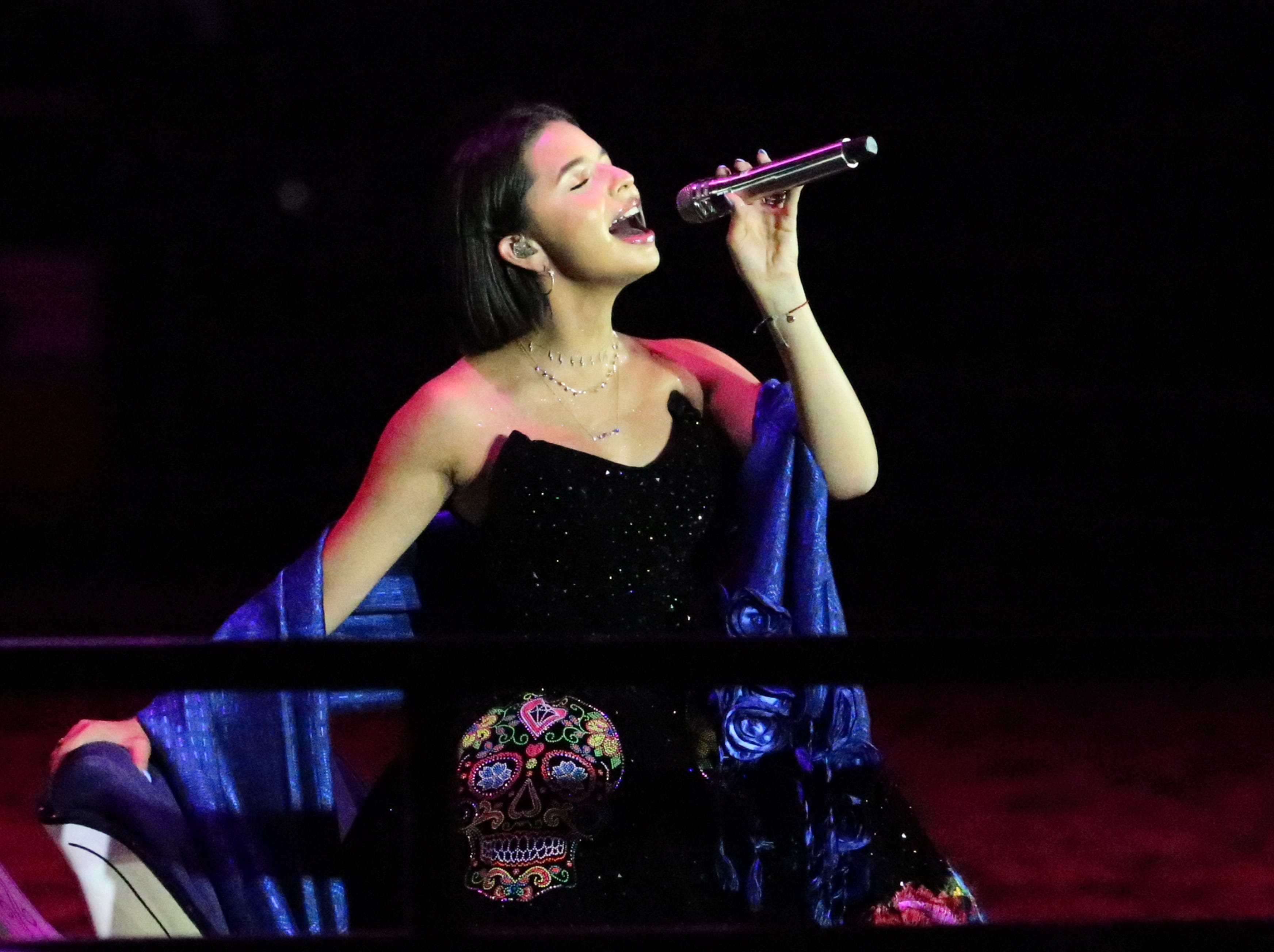 Angela Aguilar sings to the crowd Saturday night in the El Paso County Coliseum.