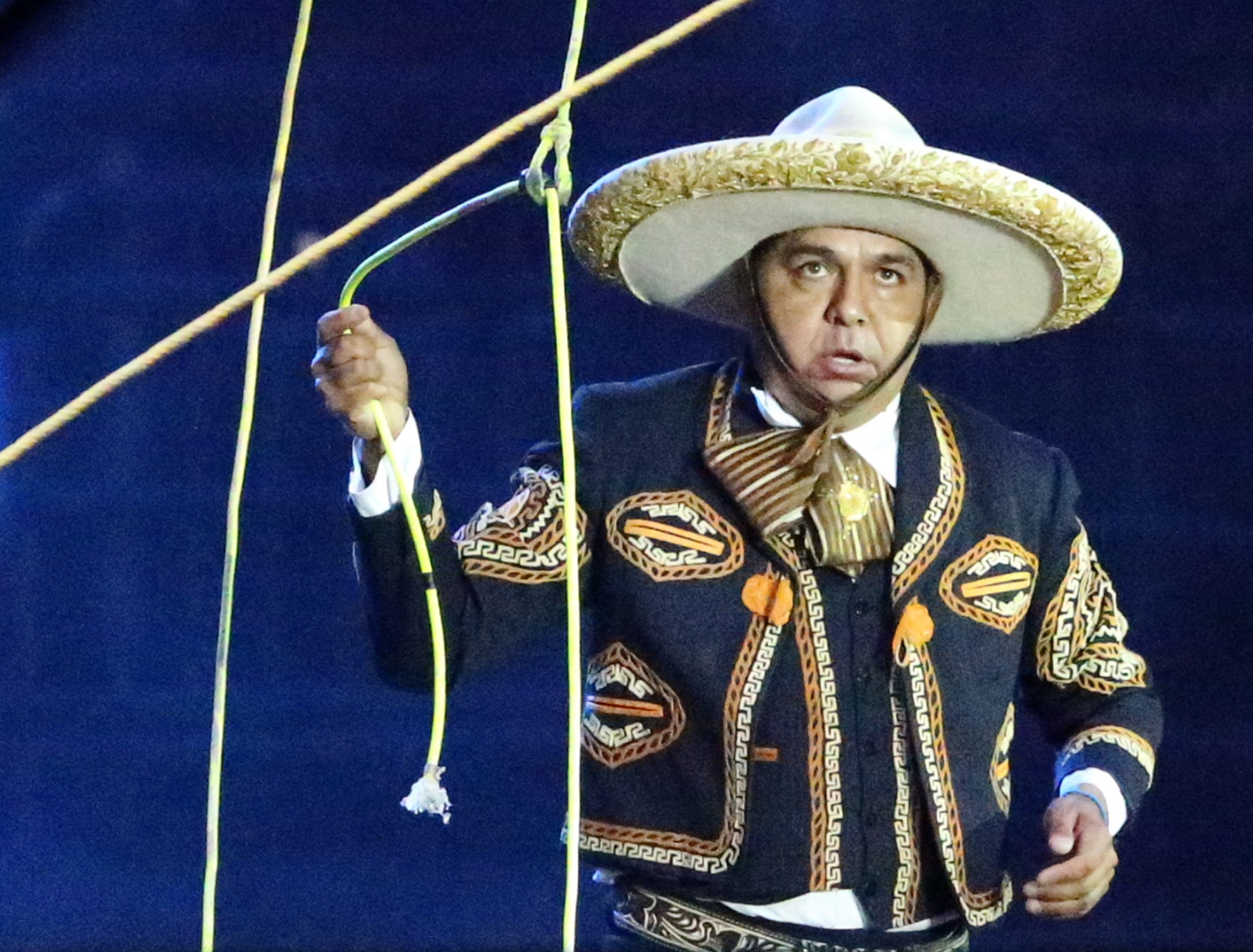 A Mexican Charro from Juarez shows his roping skill while studying a second rope turned by men on opposite ends before jumping it several times Saturday night.