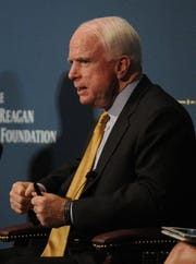 "In this Nov. 15, 2014, photo, Sen. John McCain speaks on a panel, ""From the Situation Room: A View of Defense From the White House,"" during the Reagan National Defense Forum at the Ronald Reagan Presidential Library & Museum in Simi Valley."