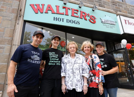 Gloria Warrington, center, wife of longtime Walter's Hot Dogs owner Eugene Warrington, with her daughter Christine Warrington and grandchildren, Gene-Christian Baca, left, Christine Sand, and Katharine Woodward on opening day of Walter's Hot Dogs in White Plains Aug. 26, 2018.