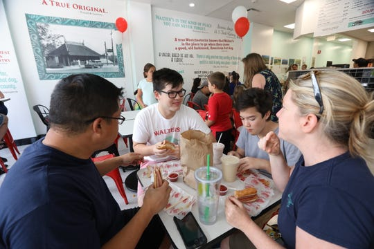 Walter's fans Patrick Liu, left, Harry Liu, 17, Hayden Claussen, 14, and Kendra Claussen of White Plains enjoy lunch at the new Walter's Hot Dogs in White Plains on opening day Aug. 26, 2018.