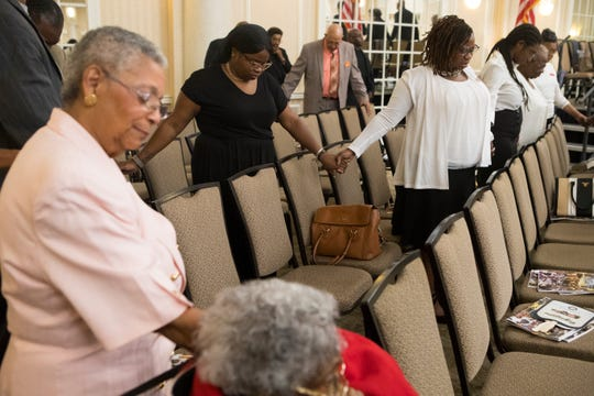 Churchgoers pray during the alter call at the end of the 205th August Quarterly Worship Service Sunday at the Chase Center.