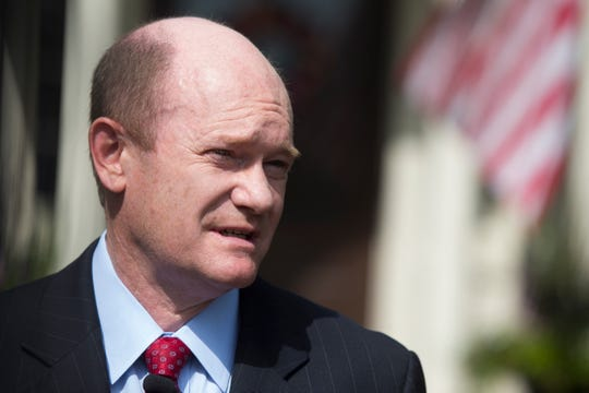 Sen. Chris Coons reflects on the impact Sen. John McCain made on his career and life as he speaks to the media in front of his home in Wilmington on Sunday.