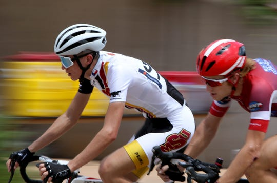 Racers compete in the Hotter'N Hell Men Pro 1-2 Criterium Sunday, Aug. 26, 2018, at the MPEC.