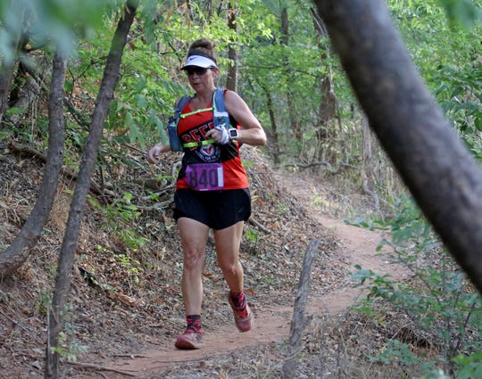 Half-marathon and 10K runners take part in the final day of the Hotter'N Hell Hundred Sunday, Aug. 26, 2018, at the J.S. Bridwell Agricultural Center.