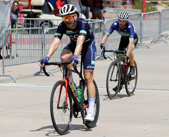 Beau Edwards of Team CCR Roofing finishes in first with a time of 59:35 in the Hotter'N Hell Men Pro 1-2 Criterium Sunday, Aug. 26, 2018, at the MPEC.