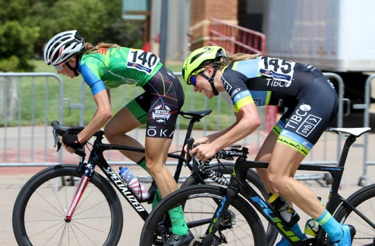 Leigh Ann Ganzar, left, and Emily Newsom compete in the Hotter'N Hell Women Pro 1-2-3 Criterium Sunday, Aug. 26, 2018, at the MPEC.
