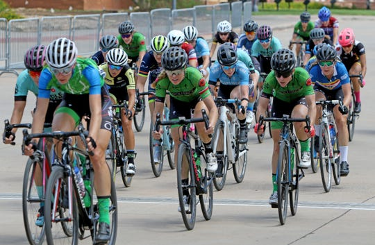 Racers compete in the Hotter'N Hell Women Pro 1-2-3 Criterium Sunday, Aug. 26, 2018, at the MPEC.