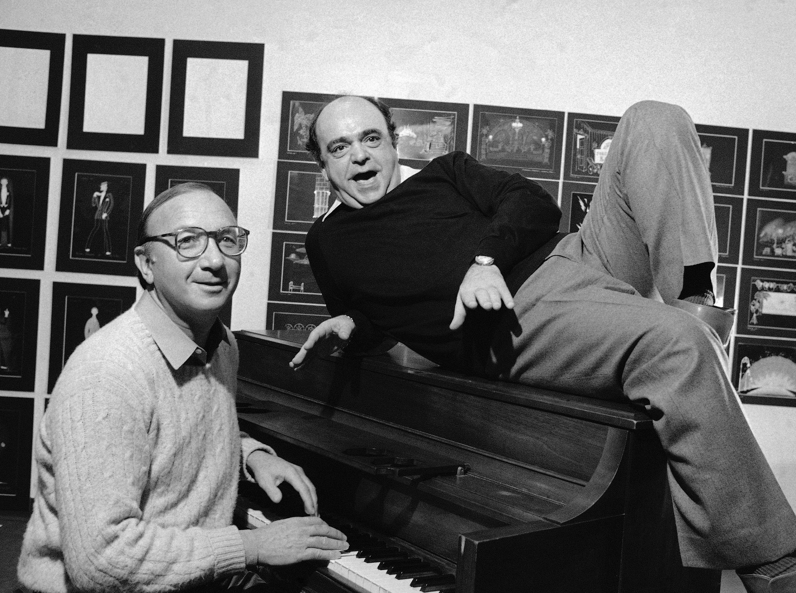 Playwright Neil Simon, left, and actor James Coco ham it up at piano, Monday, Nov. 23, 1981 in New York during the New York announcement of a Broadway bound musical comedy, ?Little Me.? Coco will star in the new show, written by Simon, along with Victor Garber and Mary Gordon Murray, slated for a Jan. 21st opening at the Eugene O?Neill Theater. (AP Photo/Lederhandler)