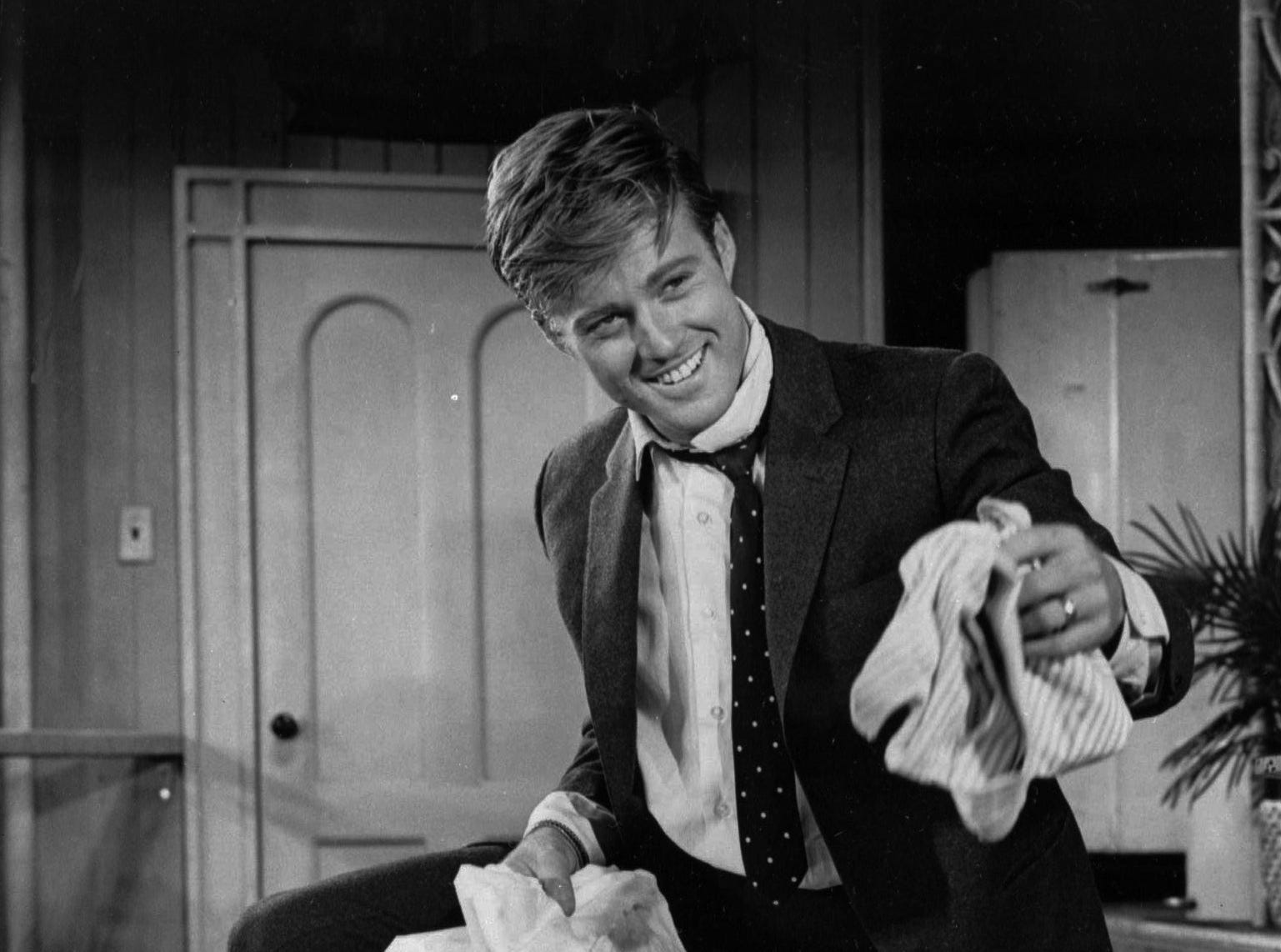 "Robert Redford's smile is a stage one in ""Barefoot in the Park."" But the 26 year old actor has plenty of reason for cheer. The comedy about a pair of newlyweds is one of the biggest hits of the 1964 season on Broadway. And it was the first hit play Redford was in on the White Way, after four flops. (AP Photo)"