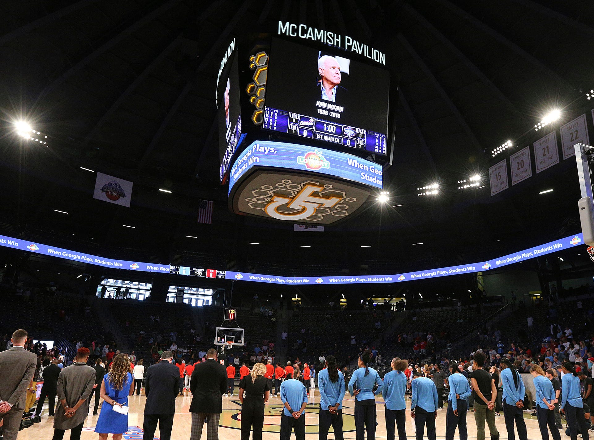 The Atlanta Dream and the Washington Mystics observe a moment of silence for Sen. John McCain prior to the start of their a WNBA basketball playoff semifinal, Sunday, Aug. 26, 2018, in Atlanta.