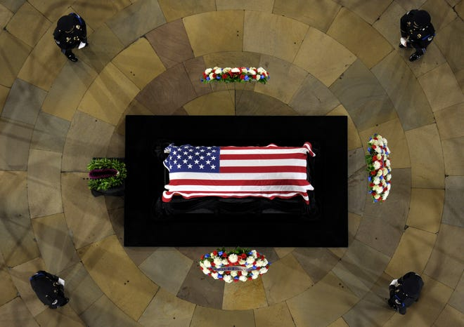 Sen. Daniel Inouye, D-Hawaii, the second-longest-serving senator in history, lies in state in the Capitol Rotunda in Washington on Dec. 20, 2012.