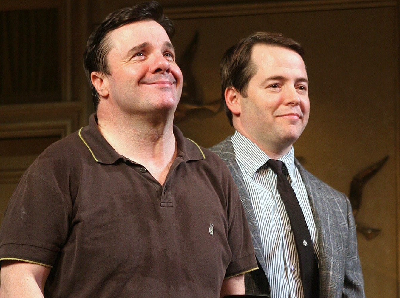"Nathan Lane, left, and Matthew Broderick look out onto the audience during the curtain call for the opening night performance of Neil Simon's ""The Odd Couple"" at the Brooks Atkinson Theatre in New York Thursday Oct. 27, 2005. Lane stars in the role of Oscar Madison and Broderick in the role of Felix Ungar. (AP Photo/Tina Fineberg)"