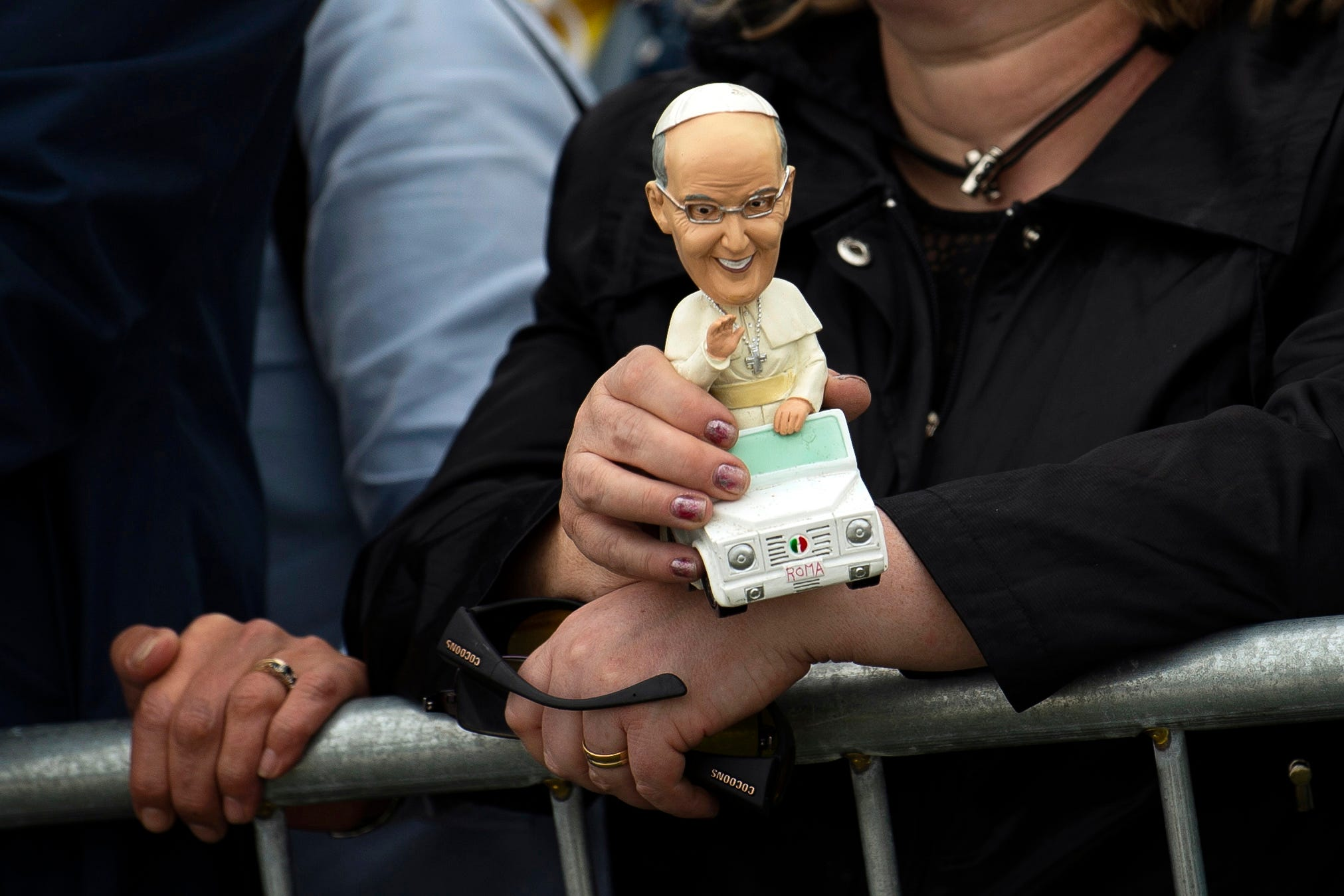 A member of the public holds a Pope Francis doll as he delivers a Papal Mass of the World Meeting of Families at Phoenix Park in Dublin, Ireland on Aug. 26, 2018.