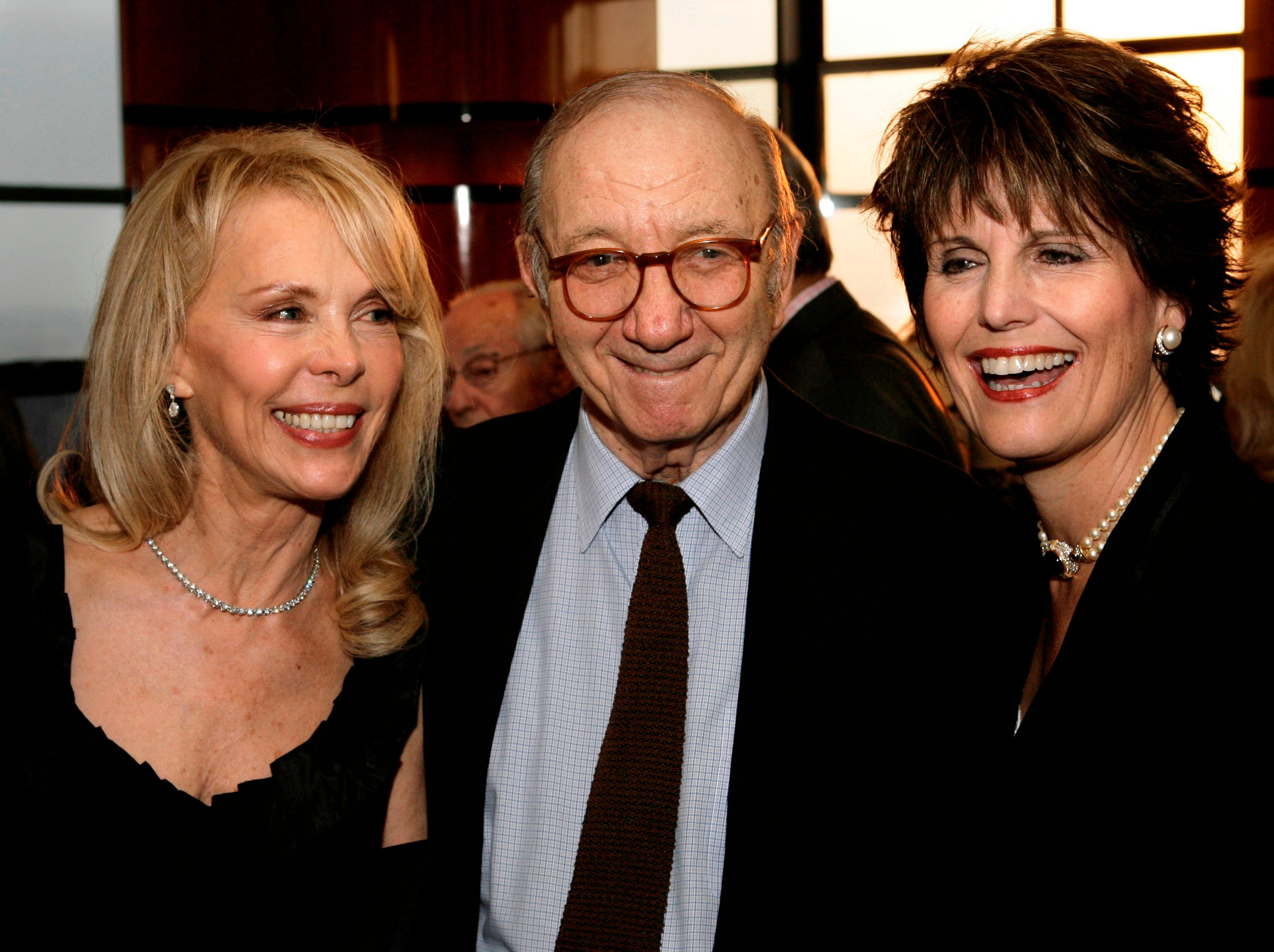 Neil Simon, center, his wife Elaine Joyce, left, and Lucie Arnaz pose for a picture at the reception for the Eugene O'Neill Theater Center's Monte Cristo Award in New York, Monday, April 21, 2008.  The award, which is given in recognition of distinguished careers, was given to playwright Simon.  (AP Photo/Seth Wenig)