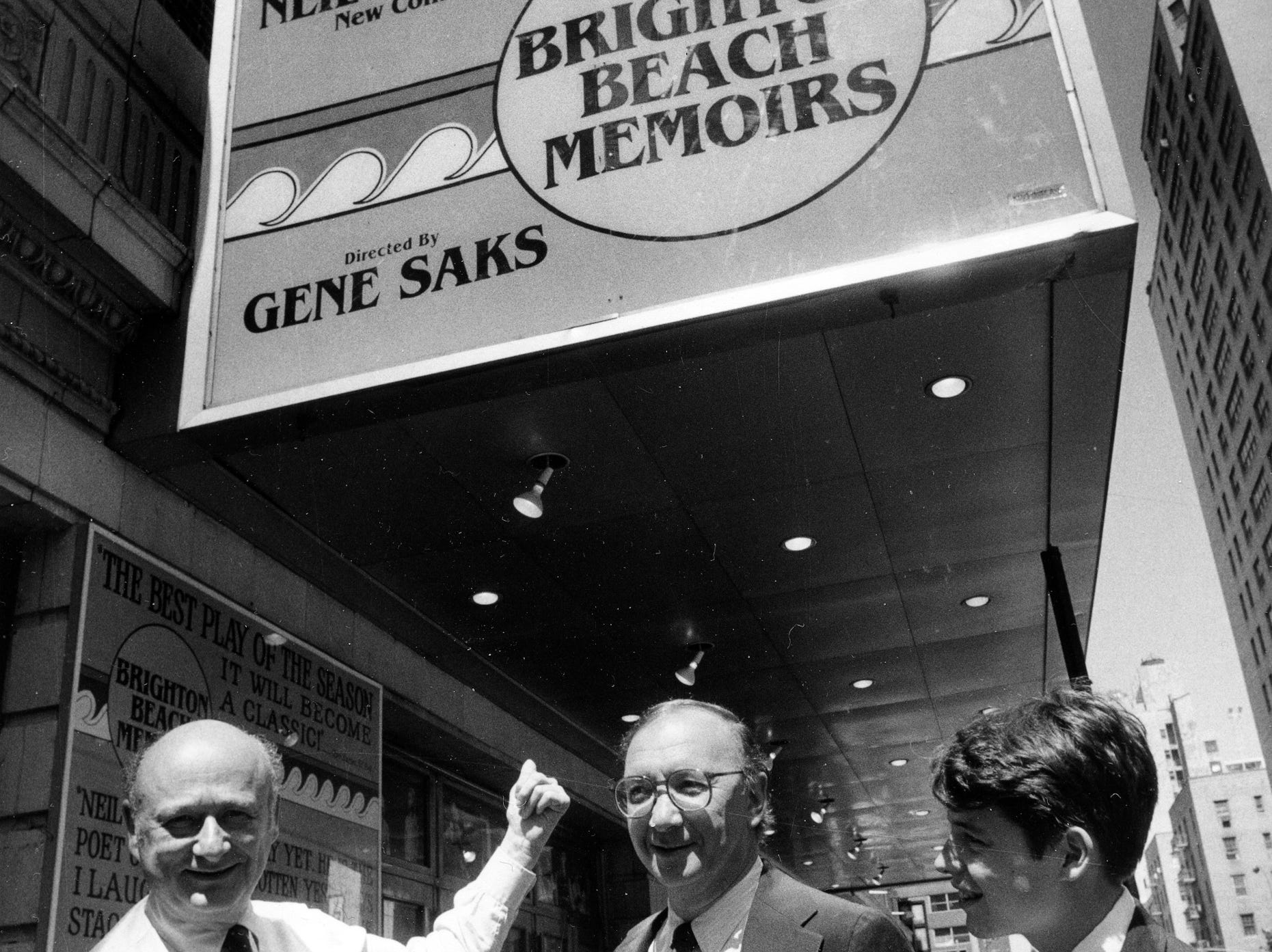 "Mayor Ed Koch, left, points to the new marquee which remanes the Alvin Theater to Neil Simon Theater, in New York, June 29, 1983. Koch is joined in the theater's dedication ceremony by playwright Neil Simon, center, and actor Matthew Broderick, right, who stars in Simon's current play ""Brighton Beach Memoirs.""  (AP Photo/Marty Lederhandler)"