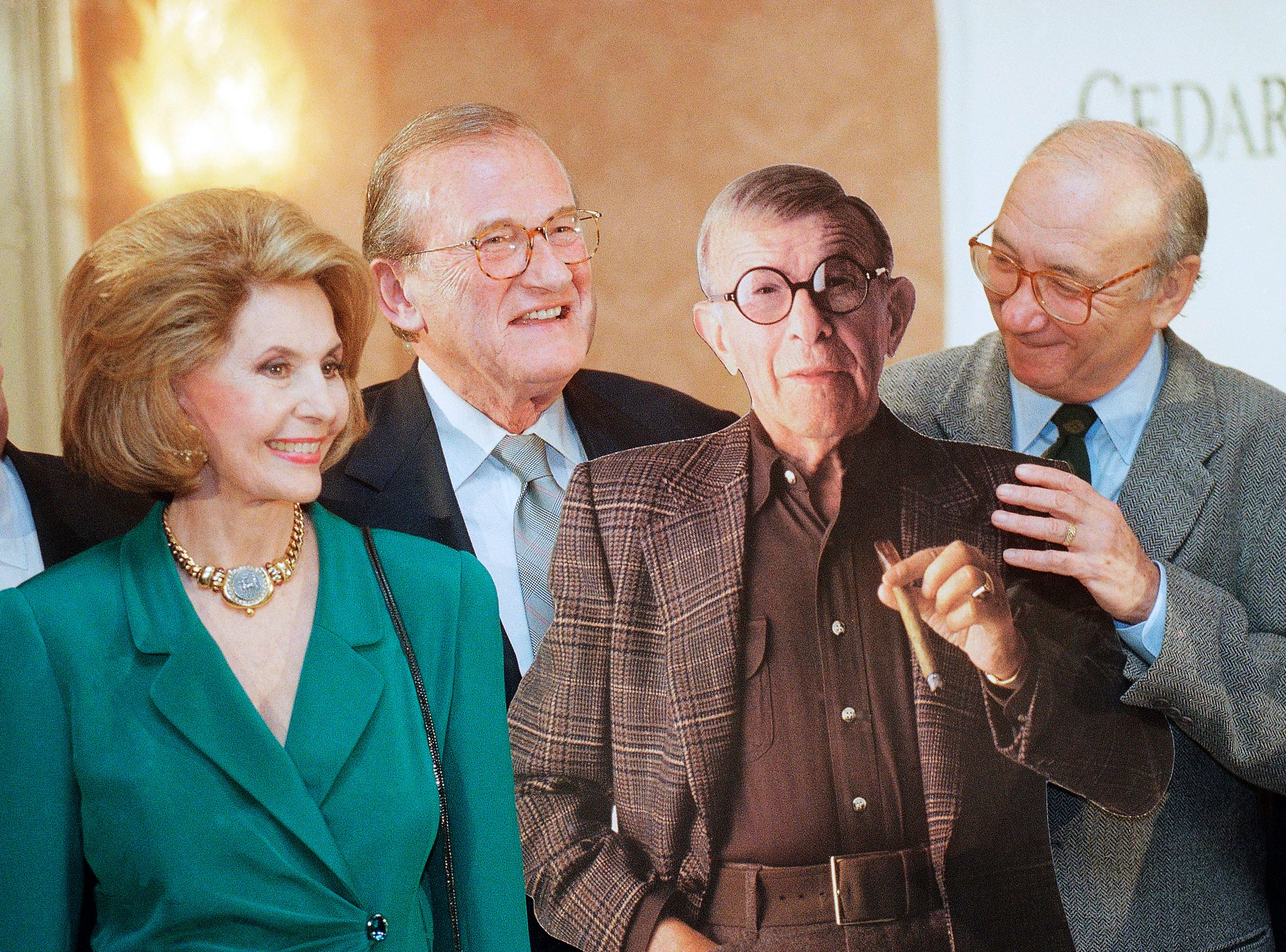 From left, entertainer Cyd Charisse, ?Oh, God? screenwriter Larry Gelbart and ?The Sunshine Boys? screenwriter Neil Simon pose with a life-size cut-out of entertainer George Burns at a news conference before a 100th birthday celebration for Burns at the Four Seasons Hotel in Los Angeles, Calif., on Tuesday, Jan. 16, 1996. Burns was forced to forego his birthday celebration because of the flu. (AP Photo/Chris Pizzello)