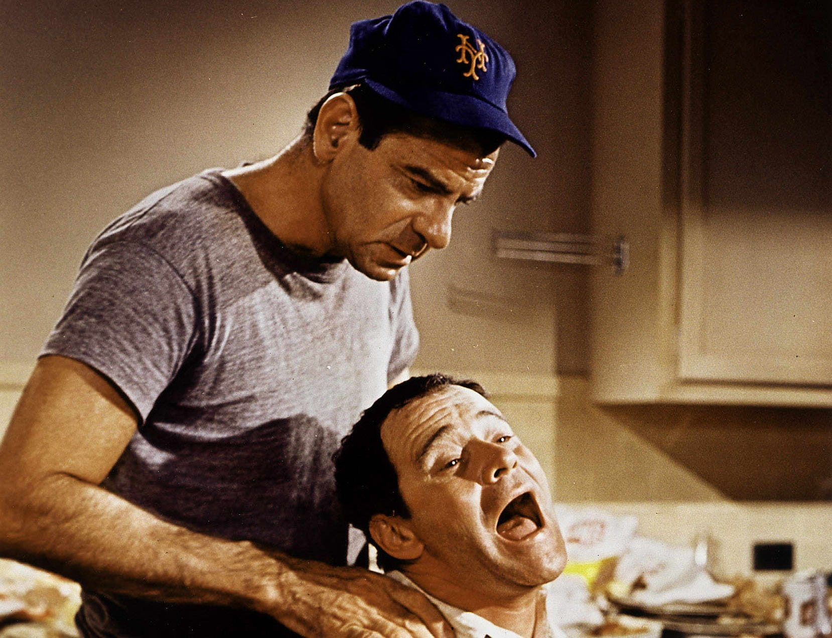 "(FILES) This 1968 file photo from the movie ""The Odd Couple"" shows actor Jack Lemmon (R) being choked by co-star Walter Matthau. Oscar-winning actor Jack Lemmon died of complications from cancer 27 June, 2001, at the age of 76.  AFP PHOTO ORG XMIT: LAX02"