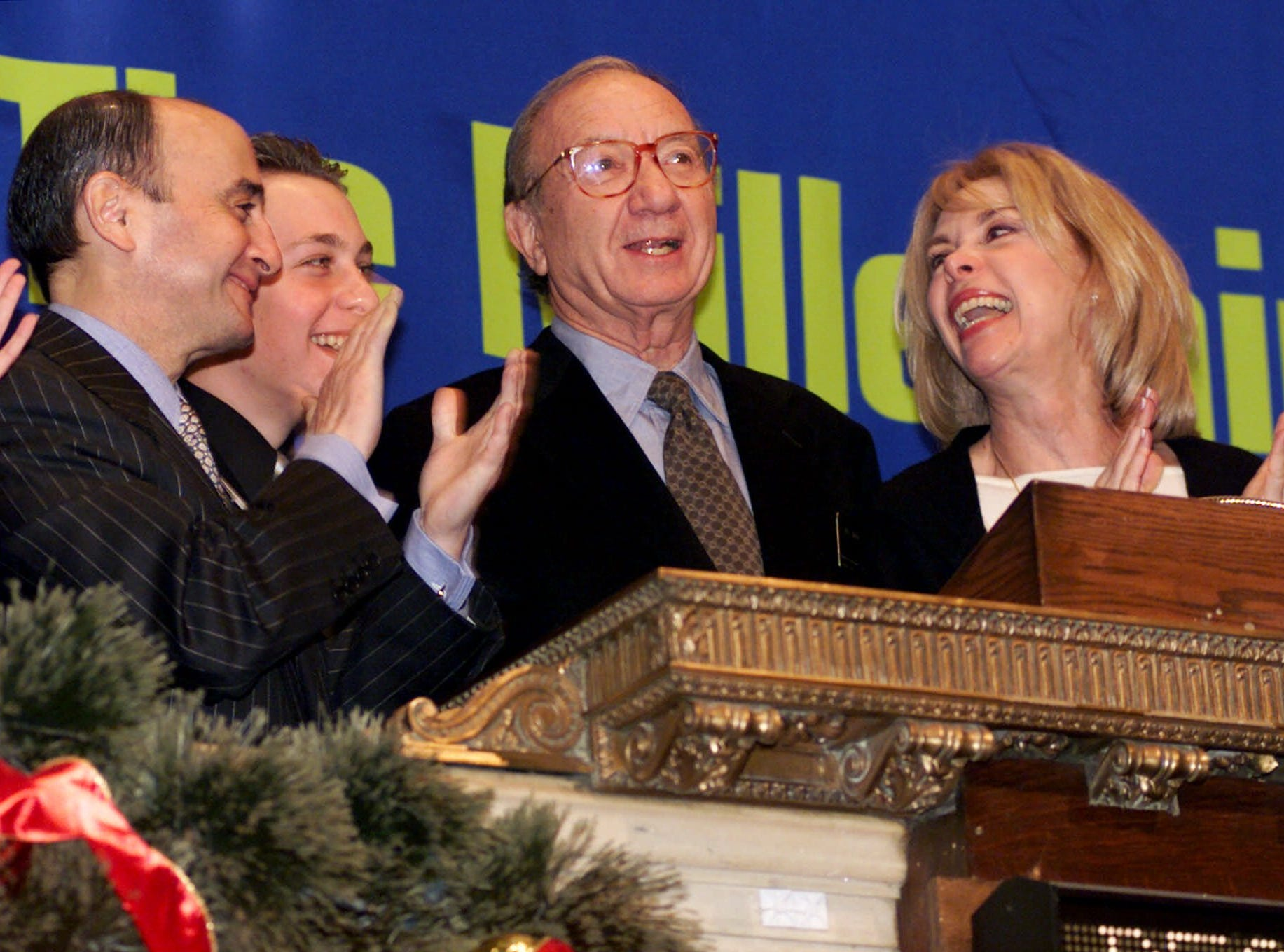Playwright Neil Simon third left, is applauded as he rings the New York Stock Exchange opening bell, Monday Dec. 27, 1999.  Simon is joined at the bell by NYSE Chairman Richard Grasso, left, Michael Levoff, Simon's stepson, second left, and wife Elaine Joyce Simon, as part of the NYSE Bridging the Millennium series. (AP Photo/Richard Drew)