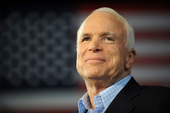 In this file photo taken on September 5, 2008 Republican presidential candidate John McCain pauses while addressing a campaign event at the Freedom Hill Ampitheatre in Sterling Heights, Michigan.