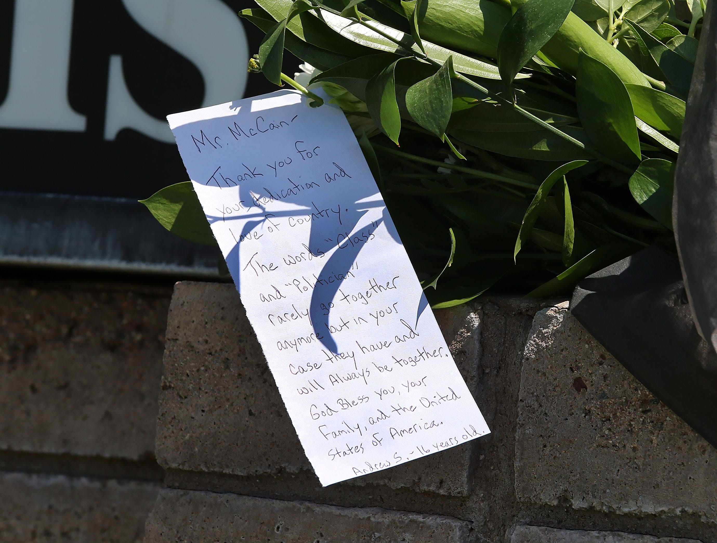 A personal note attached to flowers is left at the Dignity Memorial Mortuary to pay respects to the late Sen. John McCain on Aug. 26, 2018 in Phoenix, Ariz.