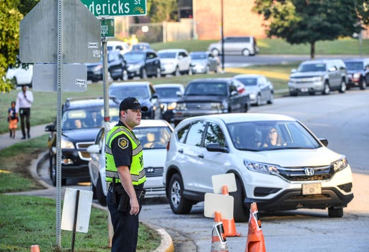 Student resource office Justin Brooks helps direct traffic and crosswalks as parents drop off children off in the morning at Concord Elementary School in Anderson in August.