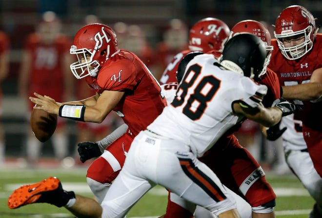 Kyle Allen of Hortonville gets away from Kaukauna defenders in Valley Football Association action Aug. 24 at Hortonville High School.