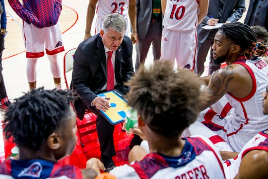 Head coach Brian Kennedy instructs NJIT players during a timeout.
