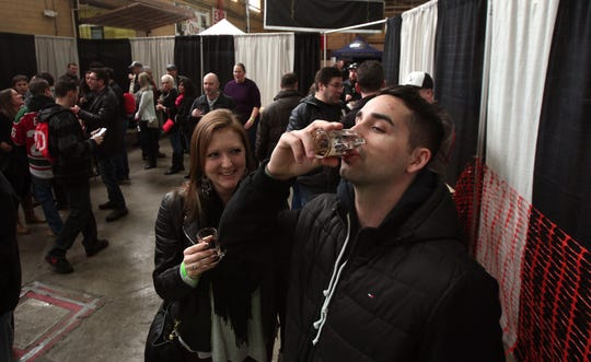 Megan Griff of Stanhope and Robert Tighe of Harrison toast to some Love Stout by the Yards Brewing Company in Philadelphia at the Big Brew Beer Festival at the Morristown Armory in 2015.