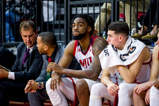 Steve Sauers, far left, on NJIT's bench during a college basketball game last season.