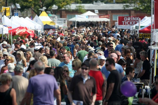 Visitors crowd the Red Bank Guinness Oyster Festival, Sunday, S.eptember 28, 2014, in Red Bank