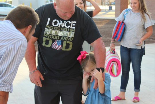 """Kennedy Gregg doesn't want to let go of her grandfather, Rodney """"Pappa"""" Gregg, or leave her family at the entrance of the new Wylie East Elementary School on Monday. Kennedy eventually made it inside for her first day of pre-kindergarten."""