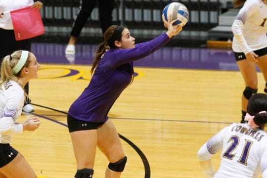 Hardin-Simmons senior Leecia DePaula sets the ball during a 2017 match. DePaula is one of six seniors set to lead the Cowgirls this season.