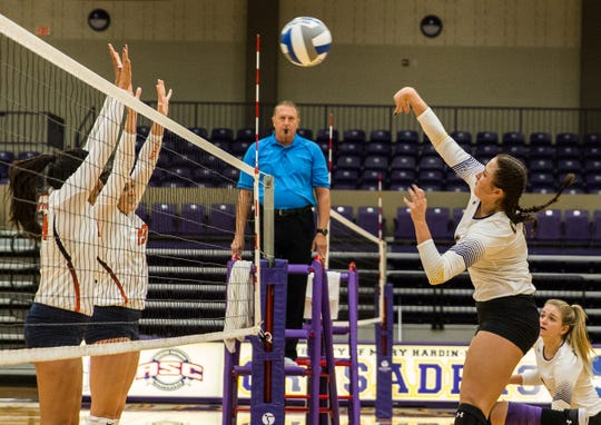 Hardin-Simmons senior Peyton Mandrell spikes the ball over the net during a 2017 contest.