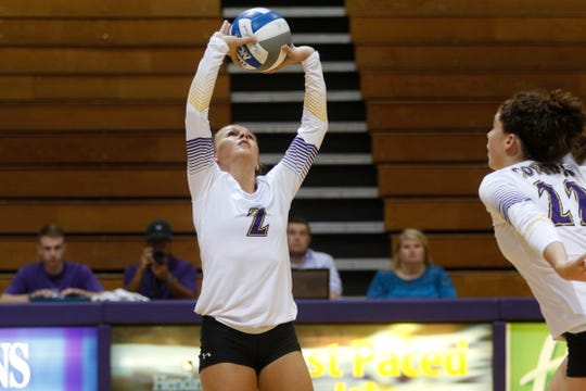 Hardin-Simmons senior Rebekah Hayes sets the ball during a 2017 match.