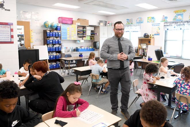 Dustin Anderson teaches his first grade class during the first day of school at Avery's Creek Elementary School on Monday, Aug. 27, 2018.