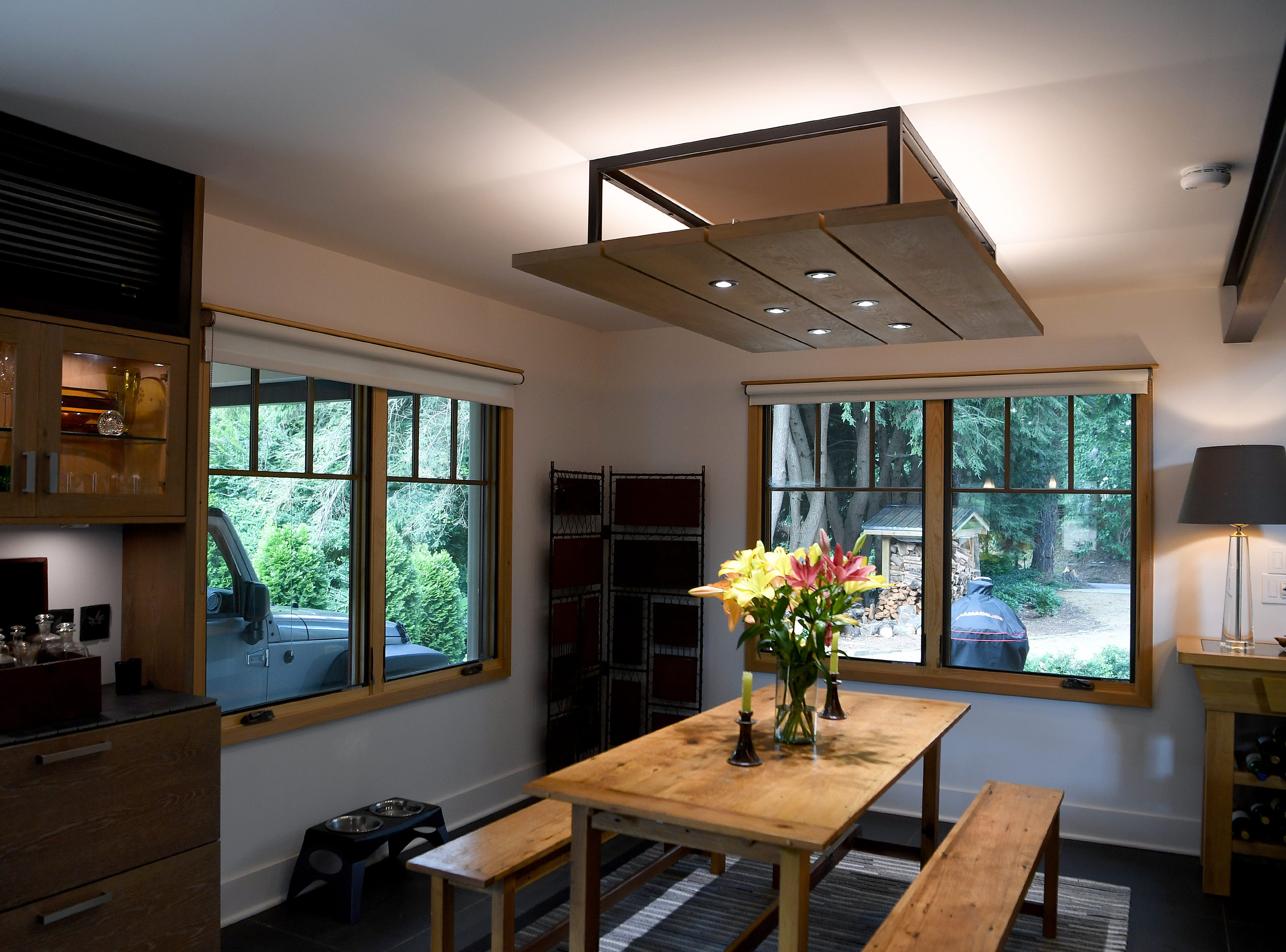 Mary Ann Myers and Annie Lundahl's North Asheville home features both down and up lighting giving the smaller space an open and modern feeling.