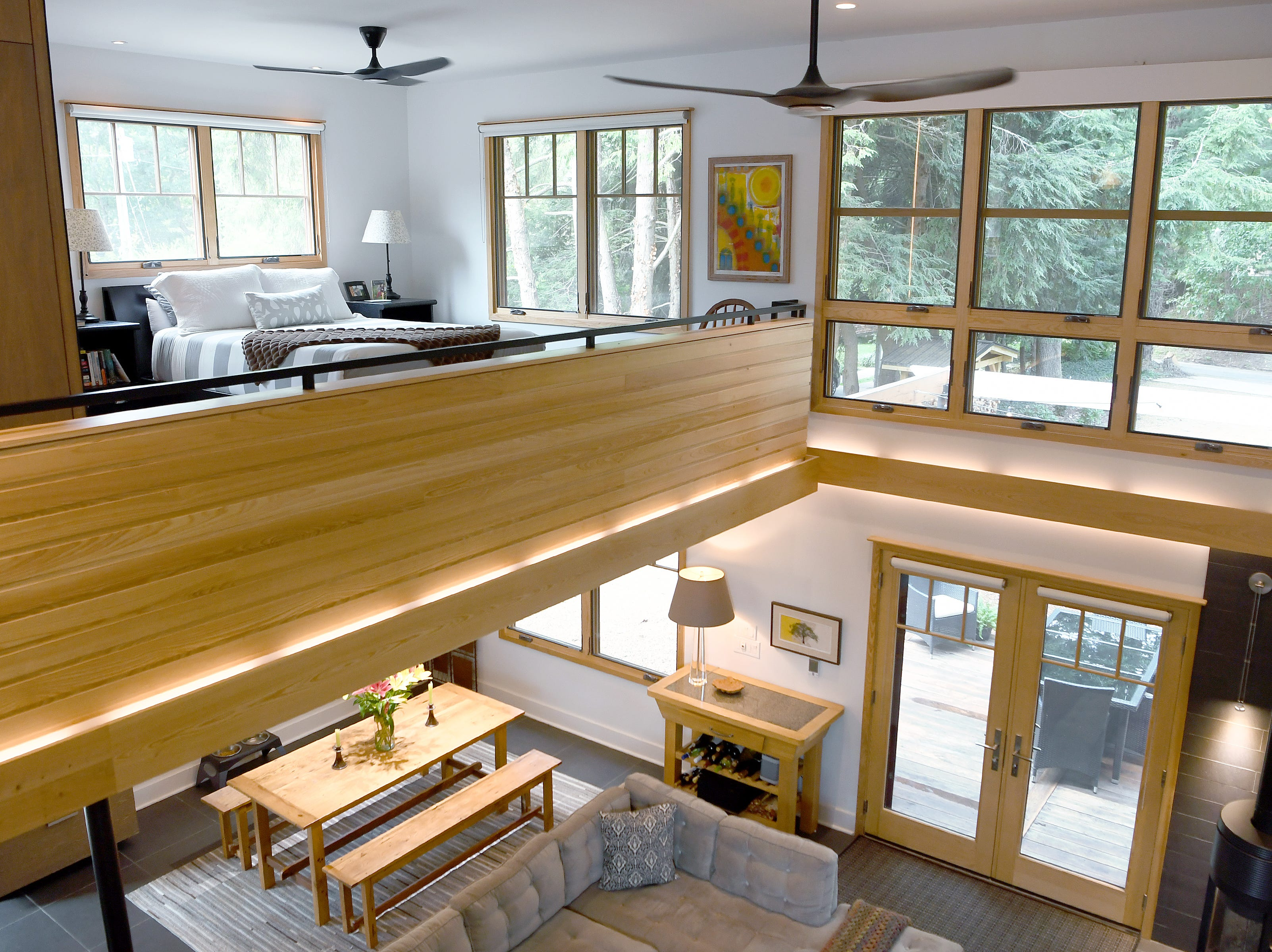 Annie Lundahl and Mary Ann Myers' North Asheville home was once an apartment complex and is now an open loft-style home with lots of windows to bring the outdoors in with modern design features.