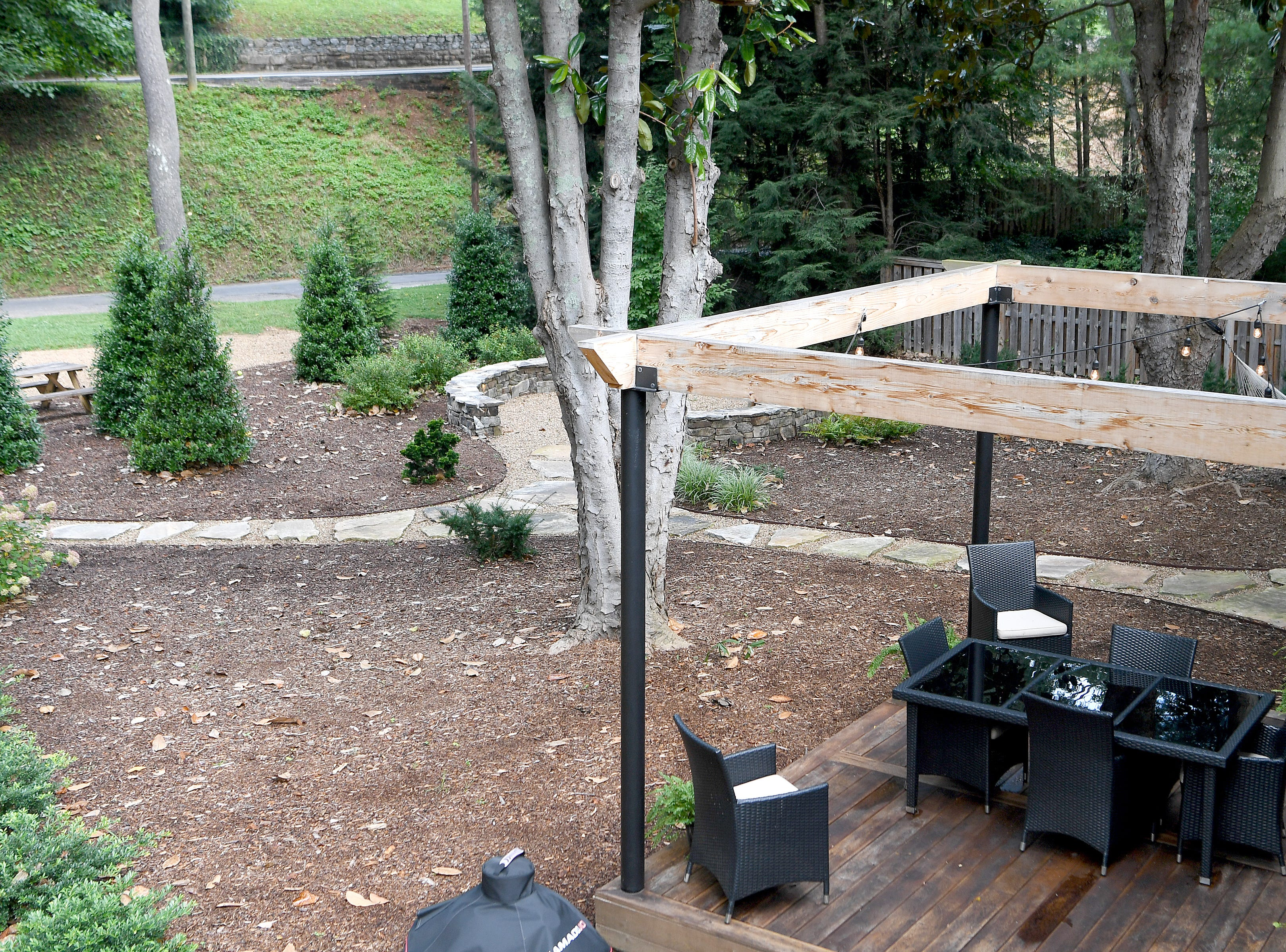 Annie Lundahl and Mary Ann Myers have made a home of what was once an apartment building in North Asheville. Their yard was once nothing but impermeable pavement and now is home to trees and beautiful landscaping as well as outdoor entertaining areas.