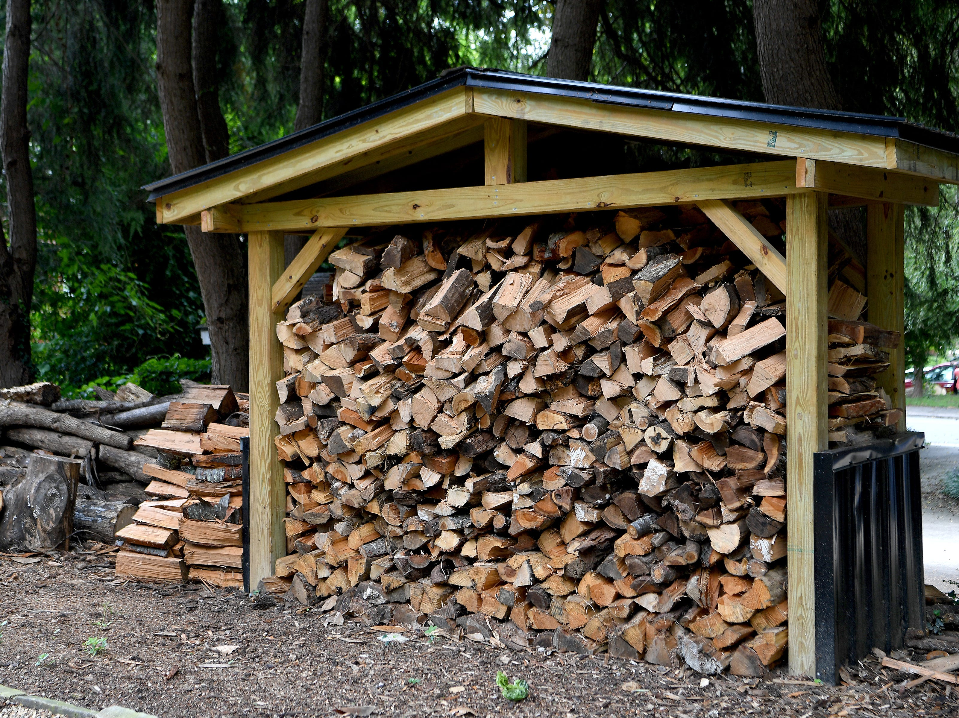 A supply of wood is ready for the winter when Annie Lundahl and Mary Ann Myers heat their home with a floor-to-ceiling wood stove.