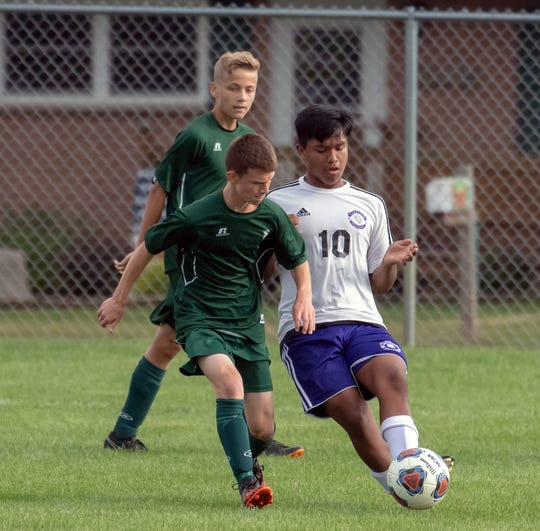 Pennfield's Justin Fourn (1) battles with Lakeview's Javier Carrillo for the ball during the first round of the 2018 All-City boys soccer tourney.